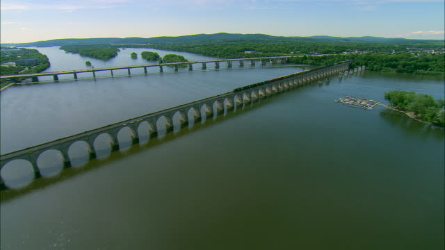 low altitude pass over bridges on the susquehanna river at harrisburg, pa - pennsylvania stock videos & royalty-free footage
