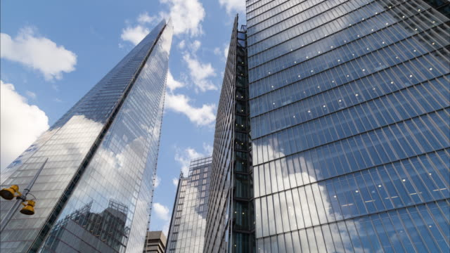 low angel 4k shard tower time lapse - office block exterior stock videos & royalty-free footage