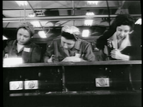b/w 1944 low angle 3 women riveting in defense plant / world war ii / industrial - 1944 stock videos and b-roll footage