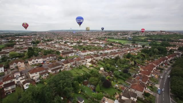 Low Angle Aerial Shot Hot air balloons take to the sky over Bristol as they launch from Greville Smythe Park close to the city centre on August 6...