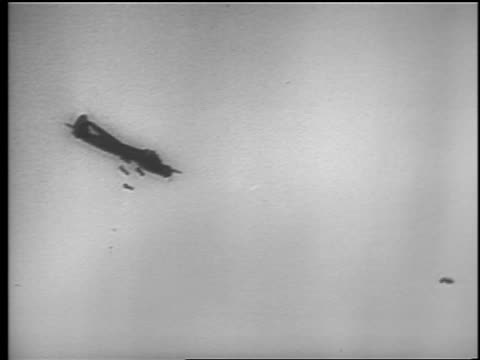 b/w 1940 low angle airplane in flight dropping bombs / london blitz / educational - bomber plane stock videos & royalty-free footage