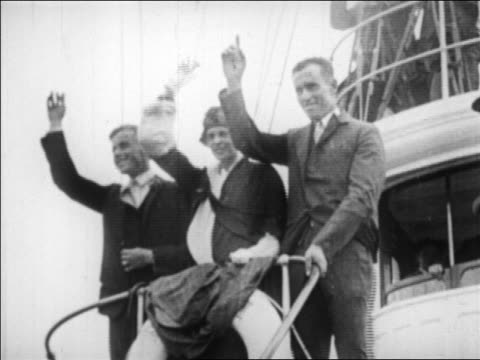 b/w 1928 low angle amelia earhart her pilot her mechanic standing on boat waving / nyc - 1928 stock videos & royalty-free footage