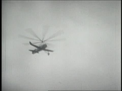 B/W 1930 low angle Amelia Earhart in autogiro landing / Hatboro PA