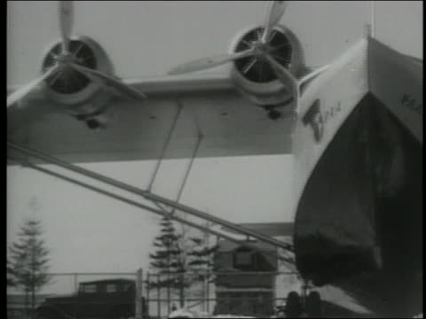 low angle american clipper plane sitting by airplane hangar - 1931 stock videos & royalty-free footage