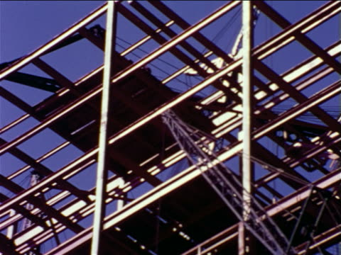 1965 low angle arm of heavy equipment moving toward steel girders on construction site / pennsylvania - construction equipment stock videos & royalty-free footage