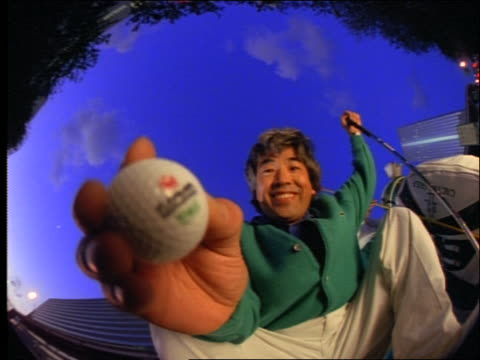 low angle asian man taking golf ball from hole - nur männer über 30 stock-videos und b-roll-filmmaterial