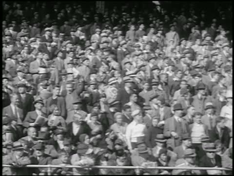 b/w 1934 low angle audience in bleachers / philadelphia - 1934 stock-videos und b-roll-filmmaterial