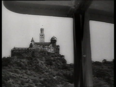 low angle boat point of view of castle on hilltop in germany / 1960's / sound - moving process plate stock videos & royalty-free footage