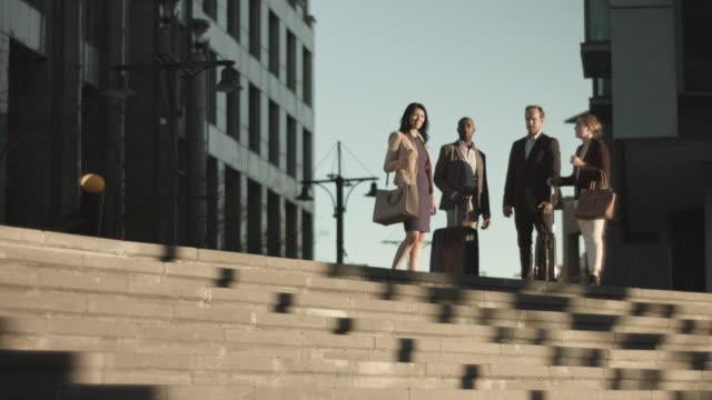 low angle, businesspeople on outdoor staircase - partnership stock videos & royalty-free footage