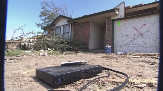 low angle ws of cable box lies outside tornadodamaged home - cable box stock videos & royalty-free footage