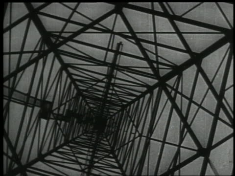 b/w 1938 low angle canted radio tower - mast stock videos & royalty-free footage