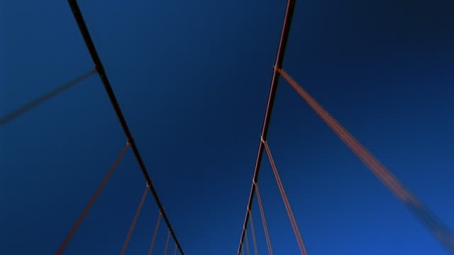 Low angle car point of view cables of Golden Gate Bridge / San Francisco