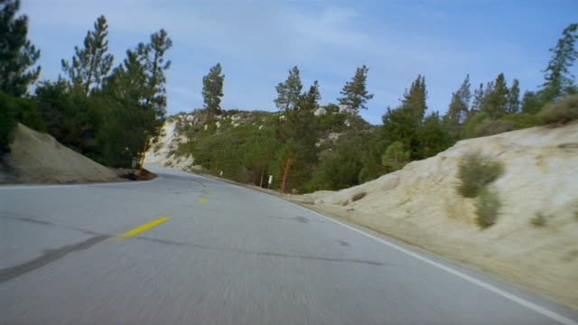 low angle car point of view driving on curving coastal road / northern california - aufnahme von unten stock-videos und b-roll-filmmaterial