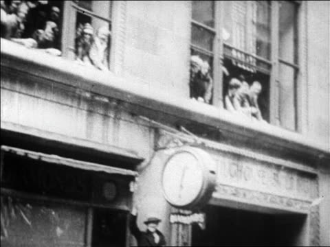b/w 1927 low angle car point of view people leaning out of windows waving at parade for charles lindbergh / newsreel - 1927 stock videos & royalty-free footage