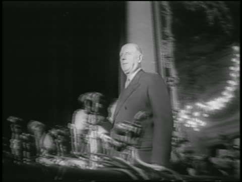 low angle charles de gaulle stepping up onto platform + sitting down behind microphones - 1958 stock videos & royalty-free footage