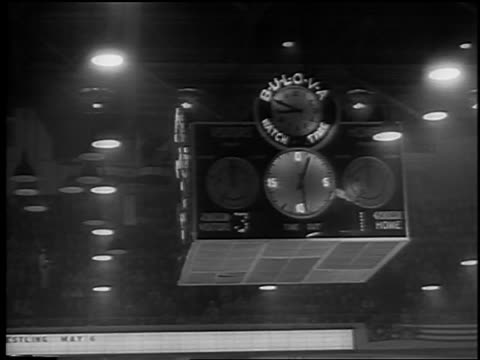 b/w 1961 low angle clock timer in olympia stadium during stanley cup / detroit / newsreel - 1961 stock videos and b-roll footage