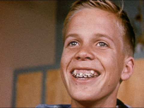 1955 low angle close up boy with braces smiling and laughing - brace stock videos and b-roll footage