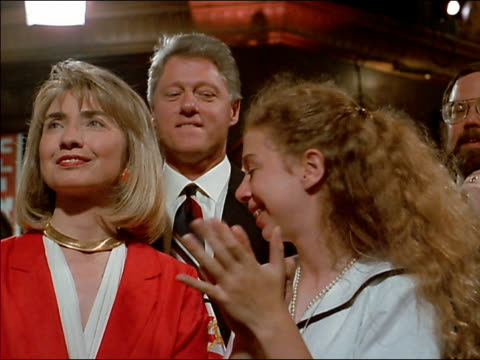 vídeos de stock e filmes b-roll de low angle close up clinton family smiling and clapping together - 1992