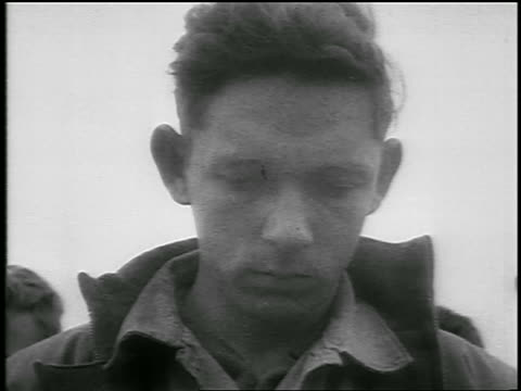 b/w 1950 low angle close up face of grieving soldier looking down / korean war / newsreel - solo uomini giovani video stock e b–roll