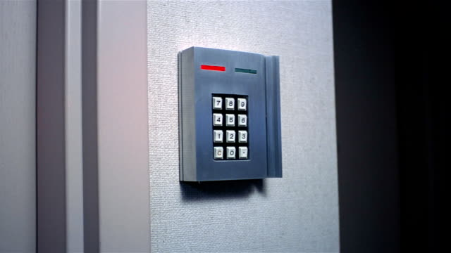 low angle close up hand punching code into security keypad / green light turning on - security code stock videos and b-roll footage
