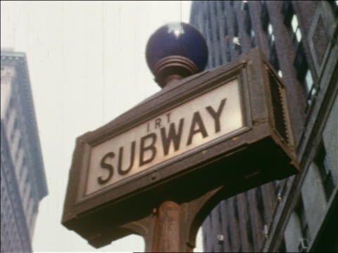 "1960 low angle close up ""irt subway"" sign with blue light on top / nyc / newsreel - 1960 stock videos & royalty-free footage"