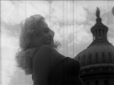 B/W 1957 low angle close up Jayne Mansfield posing in front of Capitol Building during promotional tour / DC