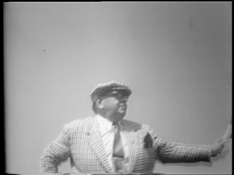 b/w 1953 low angle close up man in hat eyeglasses waving checkered flag at end of indianapolis 500 - only mid adult men stock videos & royalty-free footage
