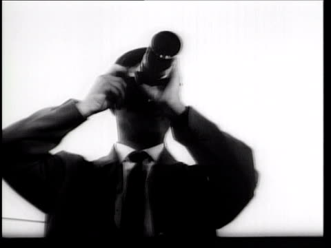 B/W 1961 low angle close up man using camera with long lens outdoors / Berlin / newsreel