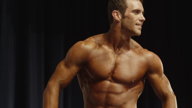 stockvideo's en b-roll-footage met low angle close up of bodybuilder exiting stage at competition / draper, utah, united states - body building