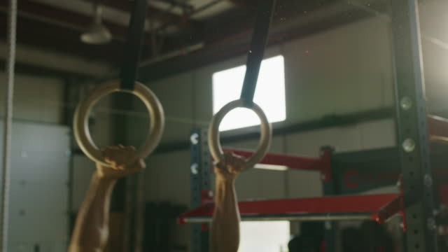 low angle close up of man swinging and lifting on gymnastic rings / lehi, utah, united states - lehi stock videos & royalty-free footage