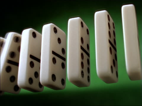 low angle close up of row of dominoes falling - dominoes stock videos & royalty-free footage