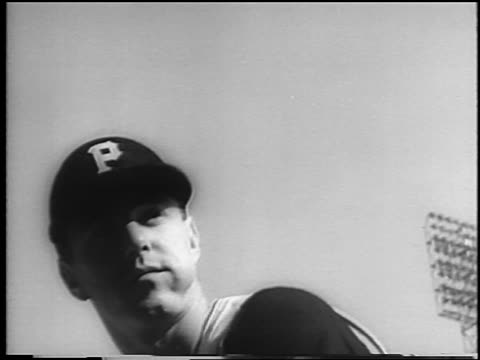 vídeos de stock e filmes b-roll de b/w 1960 low angle close up pirate bill mazeroski chewing tobacco preparing to bat at world series / newsreel - camisola de basebol