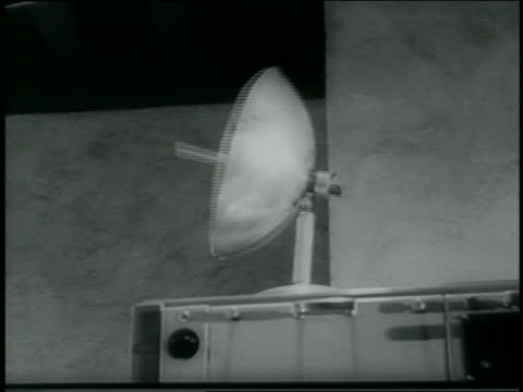 b/w 1962 low angle close up radar dish on experimental machine turning / newsreel - radar stock videos & royalty-free footage