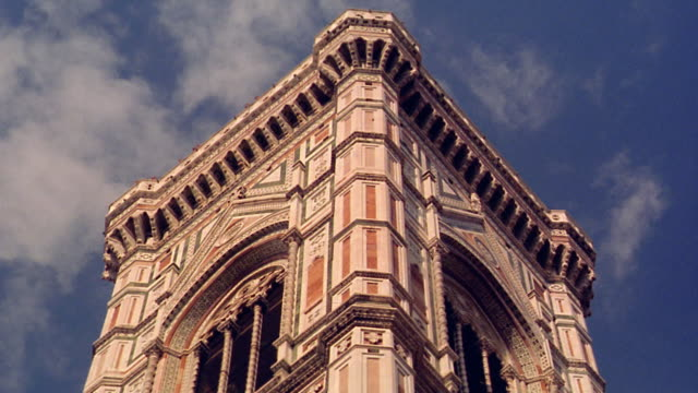 low angle close up santa maria del fiore (duomo) tower with clouds moving in blue sky / florence - florence italy stock videos and b-roll footage