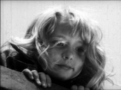 stockvideo's en b-roll-footage met b/w 1945 low angle close up smiling face of blonde girl looking down + talking / educational - alleen meisjes