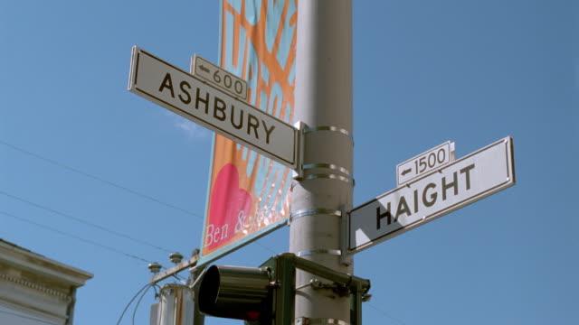 "low angle close up street signs at intersection of ""haight"" + ""ashbury"" / san francisco, ca - haight ashbury stock videos & royalty-free footage"