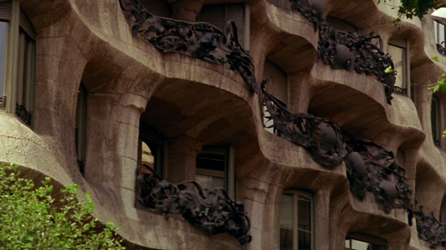 low angle close up tilt up PAN Casa Mila (Gaudi) balconies / Barcelona, Spain