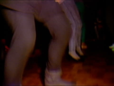 1984 low angle close up tilt up tilt down pan feet of men and women dancing in nightclub