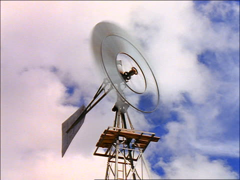 low angle close up time lapse windmill turning / time lapse clouds above / texas - anno 1997 video stock e b–roll