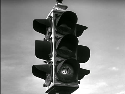 "b/w 1949 low angle close up traffic light changes from ""go"" to ""caution"" to ""stop"" - 1949 stock videos & royalty-free footage"