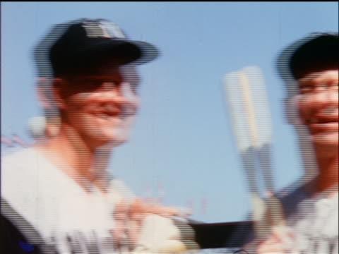 vídeos y material grabado en eventos de stock de 1964 low angle close up pan yankees roger maris mickey mantle joe pepitone posing with bats / industrial - uniforme de béisbol