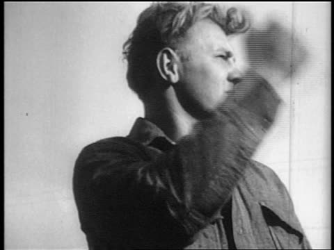 low angle close up young man with thumb raised hitchhiking - 1935 stock videos & royalty-free footage