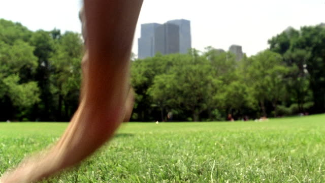 low angle close up young men doing cartwheels away from cam in central park / new york city - cartwheel stock videos & royalty-free footage