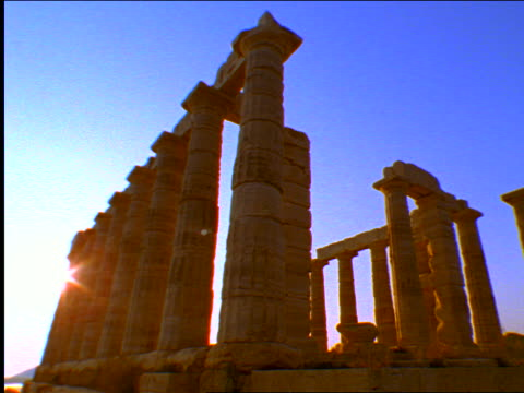 low angle columns of temple of poseidon / cape sounion, greece - sounion stock videos and b-roll footage