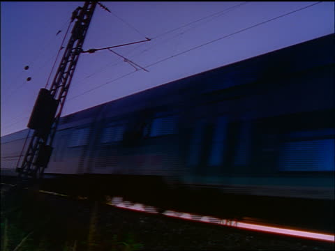 stockvideo's en b-roll-footage met canted low angle commuter train passing camera in rural area / bavaria, germany - beieren