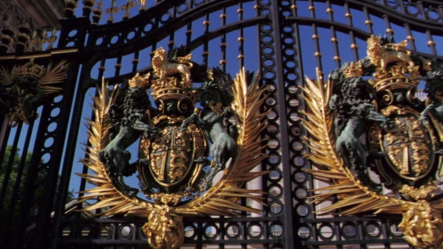 low angle dolly shot close up buckingham palace crest on gate / london, england - gate stock videos & royalty-free footage