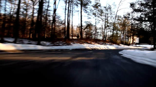 Low Angle driving suburban road home