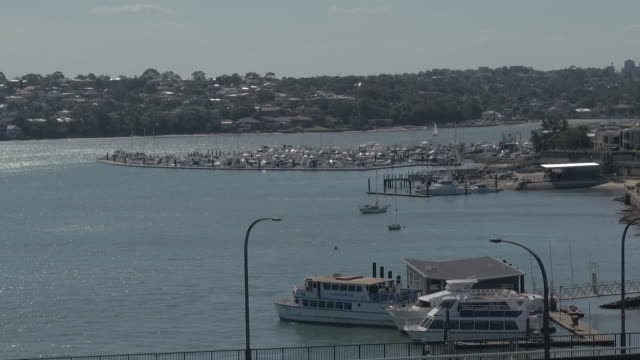 low angle drone aerial georges river san souci looking over st george motor boat club marina and georges river towards carss park drone moves over... - police boat stock videos and b-roll footage