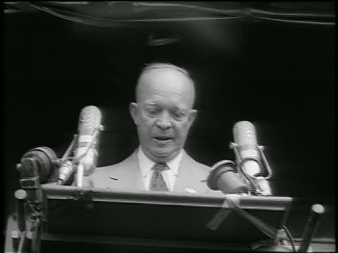 b/w 1952 low angle dwight d eisenhower making speech with microphones during whistlestop campaign / newsreel - anno 1952 video stock e b–roll
