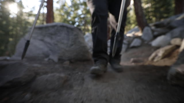 low angle establishing shot following a man hiking a rocky trail on mount whitney in california - californian sierra nevada stock videos & royalty-free footage